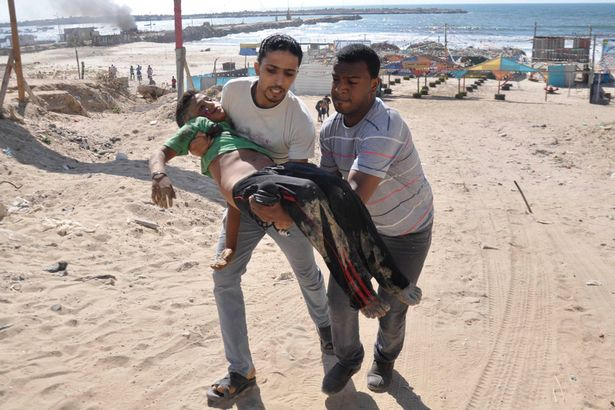 Boy killed playing football on Beach 16 July 2014.jpg