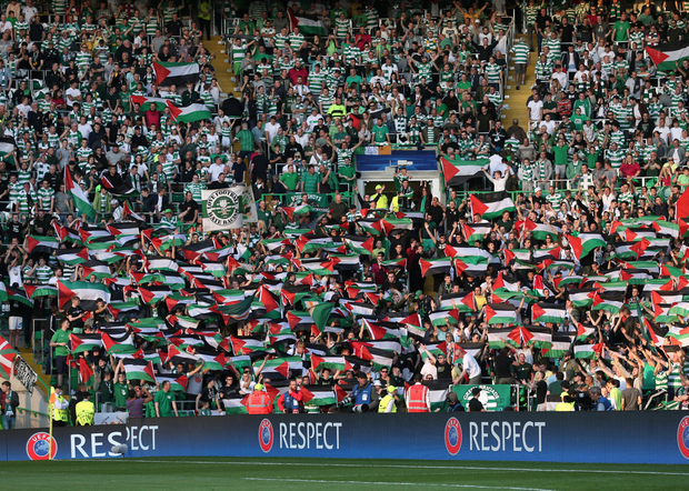 The Palestinian Flags at the Match